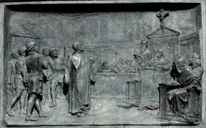 Giordano Bruno, ein italienischer Priester, Dichter, Philosoph und Astronom vor dem Inquisitionsgericht vor seiner Verbrennung, da er über das kirchliche Menschenbild hinausgehend unabhängig den Kosmos erforschte und den Weltenraum als unendlich ansah und damit dem Bild des Jüngsten Gericht widersprach.